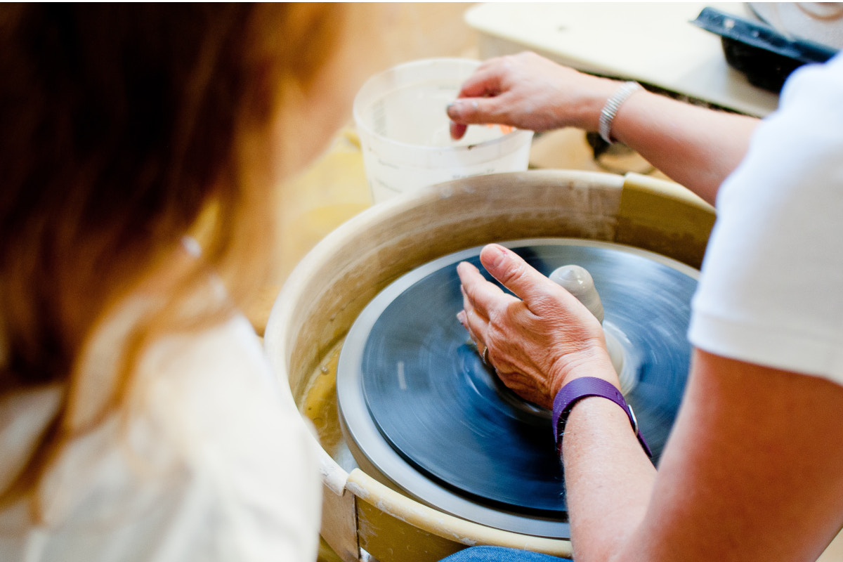 Woman spinning pottery